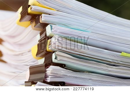 Stack Of Papers Documents In Archives Files With Clip Papers On Table At Offices,  Busy Offices And