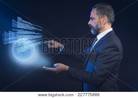 Senior Business Man Scrolling Through International News Hologram, Futuristic Concept, Or Booking A