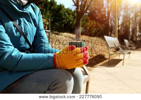 Cup Of Hot Coffee Warming In The Hands Of Girl  Outside