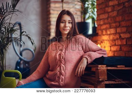 Young Charming Brunette In Stylish Clothes Sits On A Floor. Relaxing After Cleaning In A Room With L
