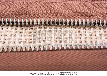 Parts Of The Brown Color Zipper On Linen Canvas Background