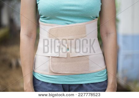 Young Asian Woman Wearing Back Support For Protect Her Back, Medicine And Healthy Concept