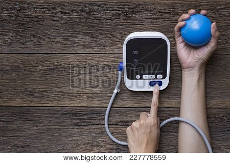 Measuring Blood Pressure And Pulse While Nervous At Table, Healthy And Medical Concept