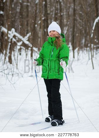 The Girl In A Ski Suit Is Turned Into A Winter Forest. The Concept Of Sports Education Of Children.