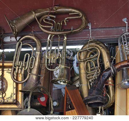 Damaged Beaten Brass Musical Instruments At Flea Market