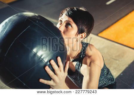 Active People Sport Workout Concept. Woman With Ball Do Fitness Exercises. Workout Exercise At Gym C