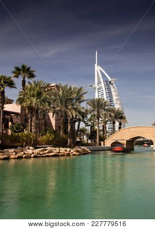 DUBAI, UAE - FEBRUARY, 2018: View on Burj Al Arab, the world only seven stars fotel seen from Madinat Jumeirah, is a luxury resort which include hotels and souk spreding across over 40 hectars.
