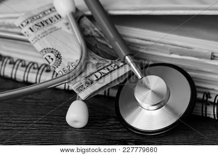 Medical Stethoscope On Dollar Bills