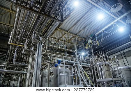 Modern Brewery Interior. Vats, Pipeline, Valves And Other Equipment Of Beer Production Line.