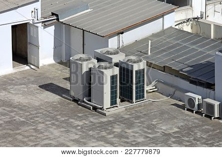 Air Conditioning External Unit With Ventilation Fans At Roof