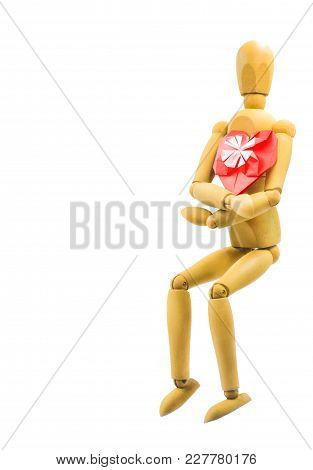 Wooden Puppet With Red Origami Heart Isolated On White Background