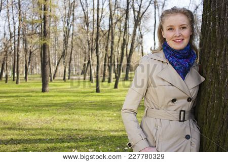 Happy Blond Young Woman In Green Spring Park Smiling, Lifestyle People Concept Close Up