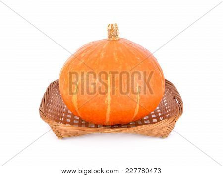 Whole Orange Japanese Pumpkin In Bamboo Basket On White Background