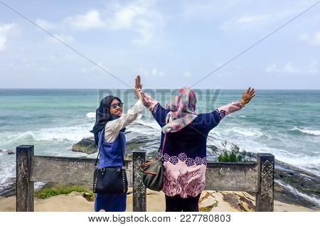 Kudat,sabah,malaysia-feb 3,2018:two Muslim Woman Raise Up Hand Freedom,showing Happiness And Enjoy V