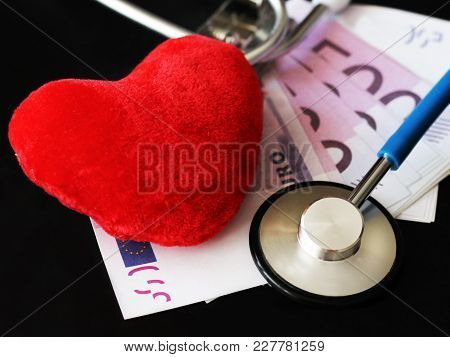 Stethoscope For Doctor And Medical Nursing People In Hospital, Healing Of Patients. Money And Red He