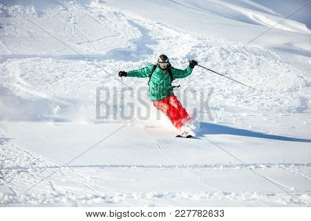 Fast Skier Freerides At Offpiste Slope. Backcountry Ski Concept