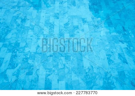 Beautiful Swimming Pool Water And Bottom Tiles Background.