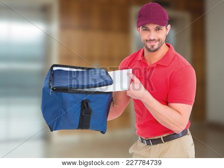 Digital composite of Happy pizza deliveryman with delivery bag and boxes in front of the elevator