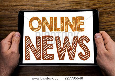 Hand Writing Text Caption Online News. Business Concept For Online Newspaper Article Written Tablet