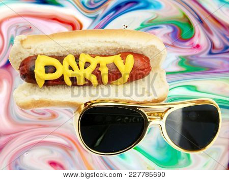 Hot Dog in bun with the word PARTY in yellow mustard and  Sunglasses on a Psychedelic Pattern Background. Its a Hot Dog or Sausage Party!