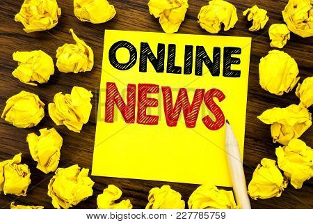 Writing Text Showing Online News. Business Concept For Online Newspaper Article Written On Sticky No