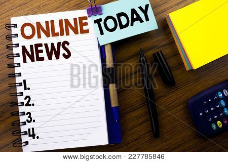 Word, Writing Online News. Business Concept For Online Newspaper Article Written On Book Note Paper