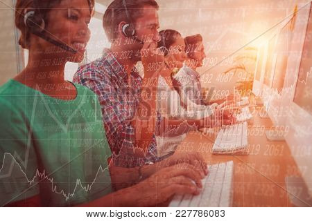 Business team working at the call centre against stocks and shares