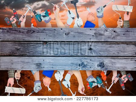 Digital composite of A lot of hands with different tools on wood with sky and brown backgrounds