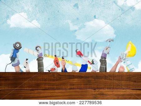 Digital composite of A lot of hands with different tools with wood and sky background