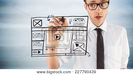 Digital composite of Business man with marker and website mock up against blurry grey wood panel