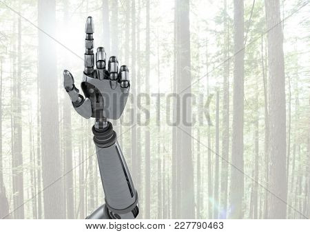 Digital composite of Android Robot hand pointing with bright forest background
