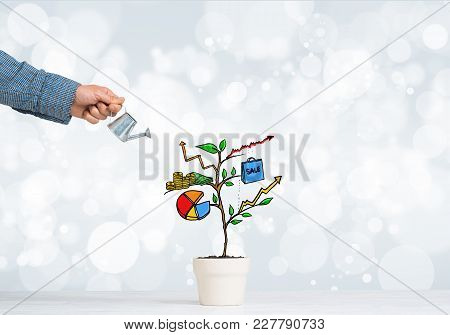 Hand Of Man Watering Concept Of Business Plan And Strategy