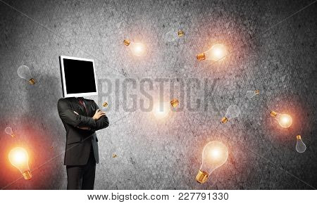 Businessman In Suit With Monitor Instead Of Head Keeping Arms Crossed While Standing Among Flying Li