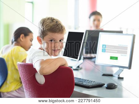 Digital composite of Happy boy in computers class