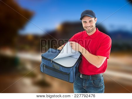 Digital composite of Happy pizza deliveryman with delivery bag in the city at evening