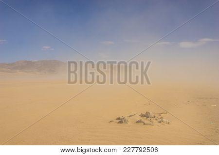 Sandstorm Around Desert Rocks