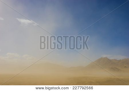 Sandstorm And Rocky Mountains