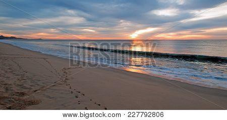 Sunrise Over Beach And Charter Fishing Boat In San Jose Del Cabo In Baja California Mexico Bcs