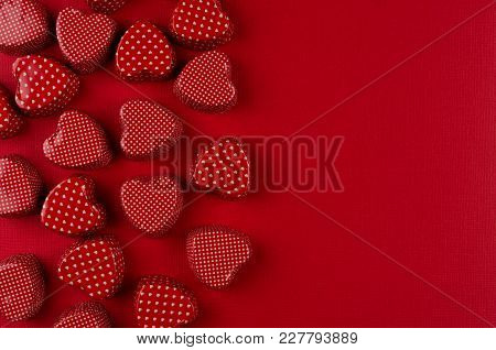 Red Hearts Candy Pattern On Deep Red Paper With Copy Space. Valentine Day Background.