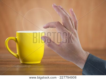 Digital composite of Hand Touching air with cup