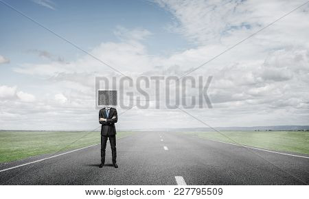 Businessman In Suit With Monitor Instead Of Head Keeping Arms Crossed While Standing On The Road Wit