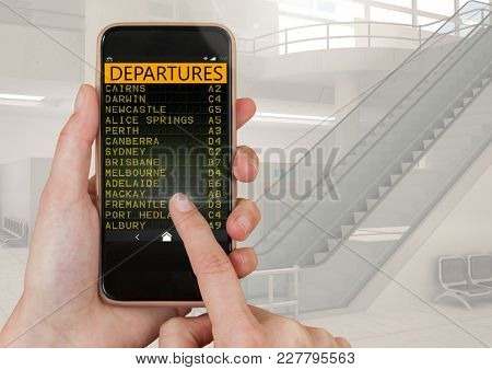 Digital composite of Hand touching mobile phone and a Flight Departures Airport App Interface