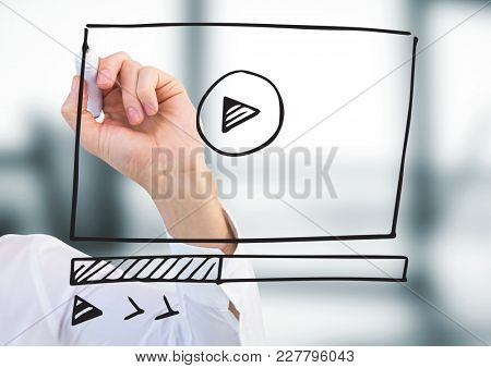 Digital composite of Arm with marker against website mock up in blurry office