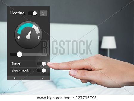 Digital composite of Hand Touching Home automation system heating App Interface