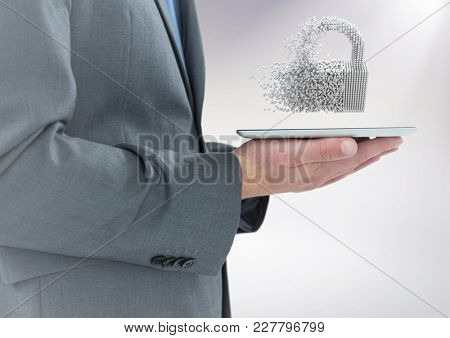 Digital composite of Business man mid section with tablet and 3D lock graphic