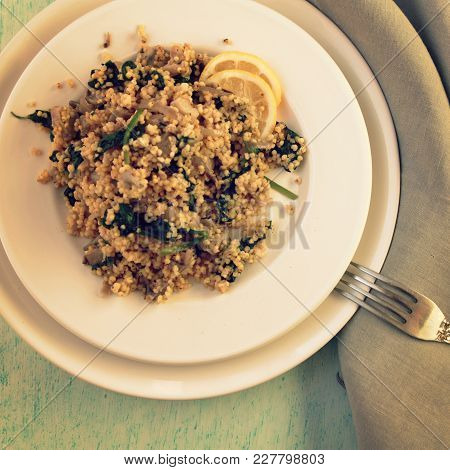 Millet With Mushrooms And Spinach. Vegan Dish. Vegetarian Couscous On The Round White Plate. Top Vie