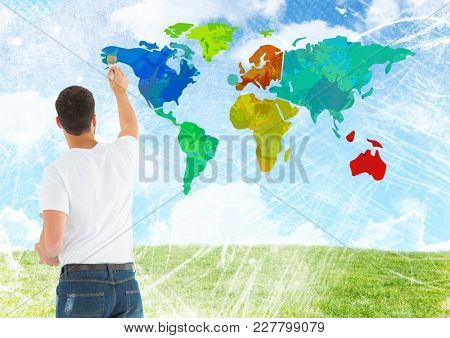 Digital composite of Man painting Colorful Map with bright sky background