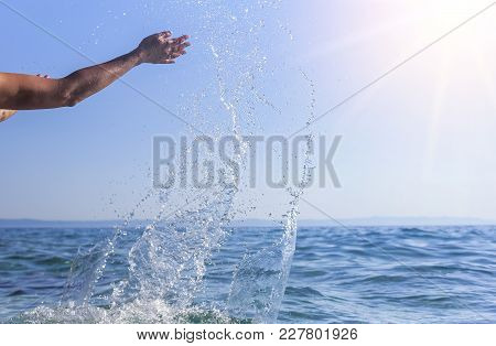 Women's Hands Do The Spray Of The Sea.