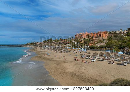Beautiful Coastal View Of  El Duque Beach With With Warm Turquoise Water And Gold Sand In Costa Adej