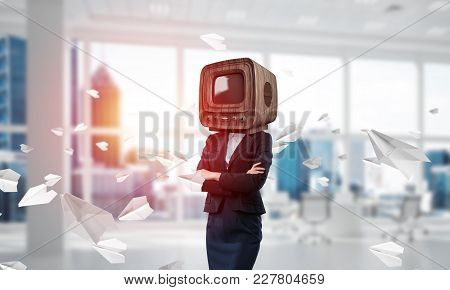 Cropped Image Of Business Woman In Suit With Old Tv Instead Of Head Keeping Arms Crossed While Stand